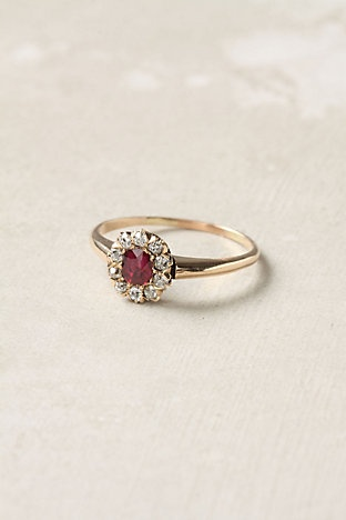ruby-I inherited a ring exactly like this from my mother. My dad found it  at a park with a metal detector.