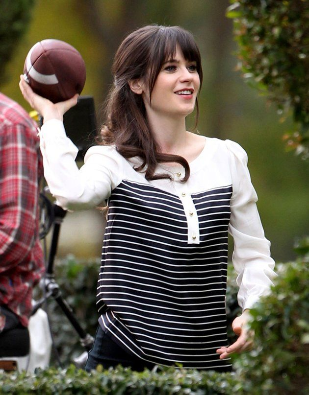 """Zooey Deschanel showed off a different set of skills when she threw the football around while on the L.A. set of her Fox sitcom """"New Girl."""" (1/23/2013)"""