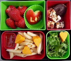 Penne Pasta with Marinara and Cheddar Cheese, Green Salad, Strawberries, Apple, Cashew Clusters, Dark Chocolate, Almond Buttercups