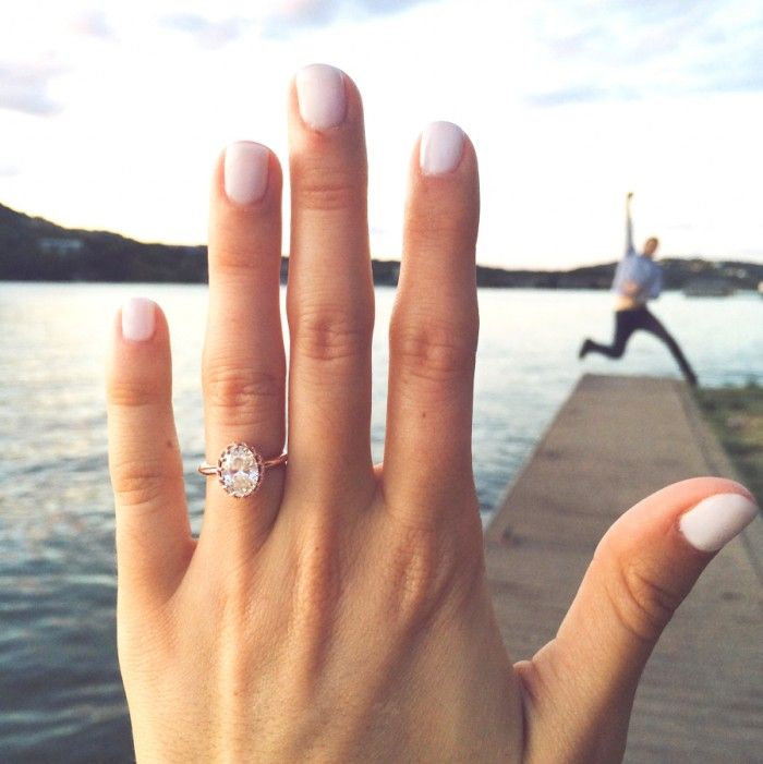 This engagement ring is so gorgeous! And the fiance celebrating in the background is just adorable. <3
