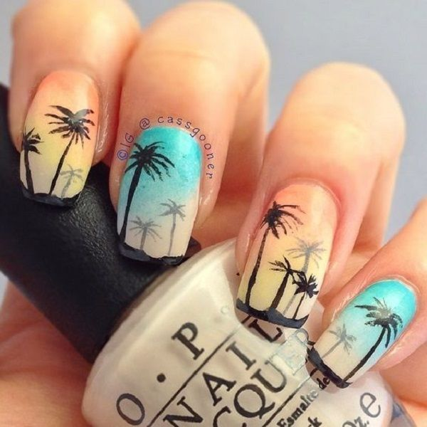 A rather pretty scenery of Palm Tree Nail Art designs. The nails have alternating backgrounds in yellow and blue. The backgrounds serve as the skies as the silhouettes of the palm trees are drawn in front of it. You can also see small silhouettes of palm trees from the horizon.