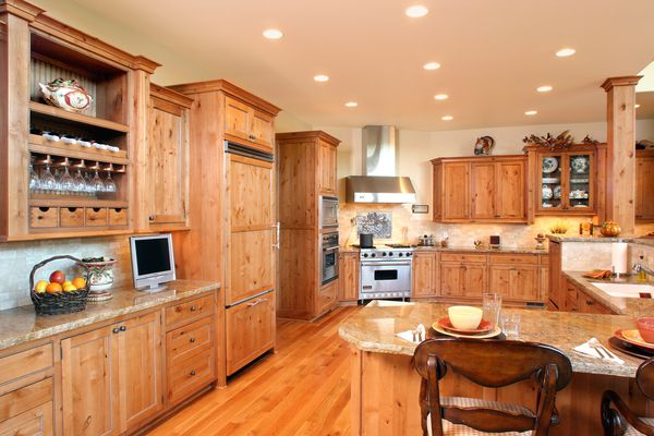 Bigthumb kitchen  craftsman style  knotty alder  light color  recessed panel  flush mount  glazed  staggered heights  refrigerator front panels  raised dishwasher  front dovetail drawers  angled hood