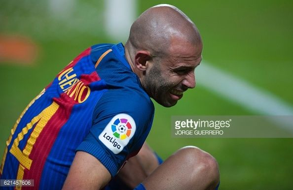 Barcelona's Argentinian midfielder Javier Mascherano reacts as he sits on the pitch during the Spanish league football match Sevilla FC vs FC...