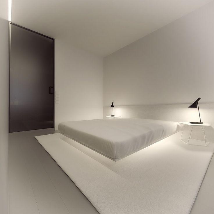 plataforma flotante para la cama en el dormitorio al estilo minimalista