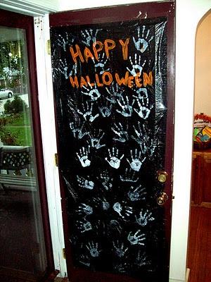 Spooky Door Cover Ghost Hands Decoration {Halloween handprint craft}