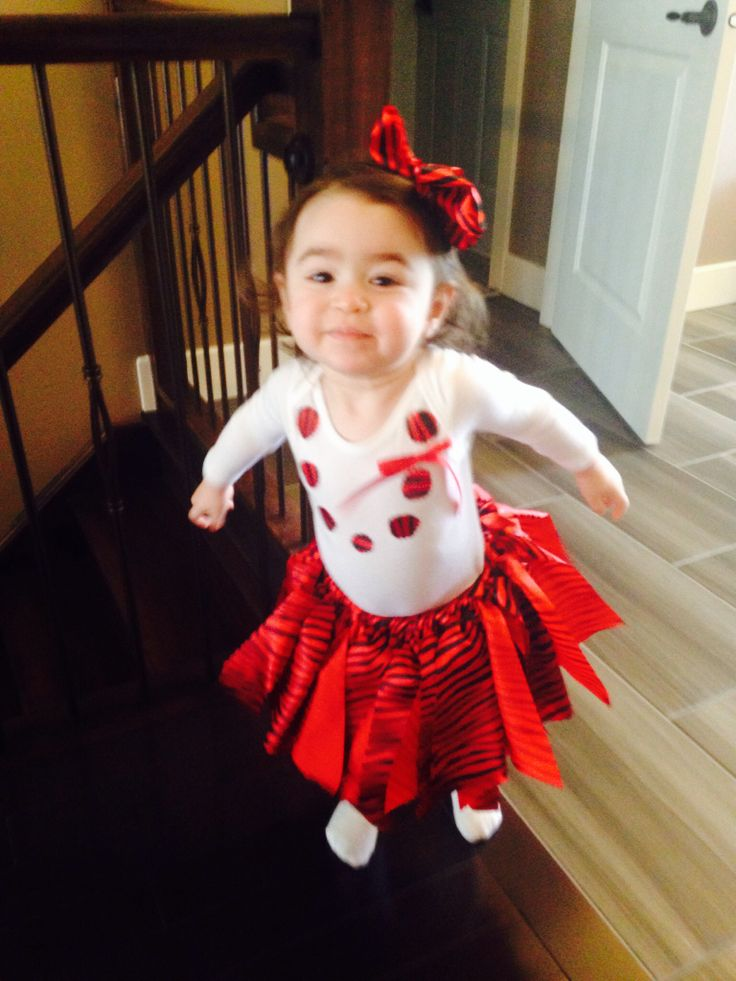 My baby girl wearing the tutu set that I made for her ~ satin tutu skirt & necklace onesie & hair clip satin bow