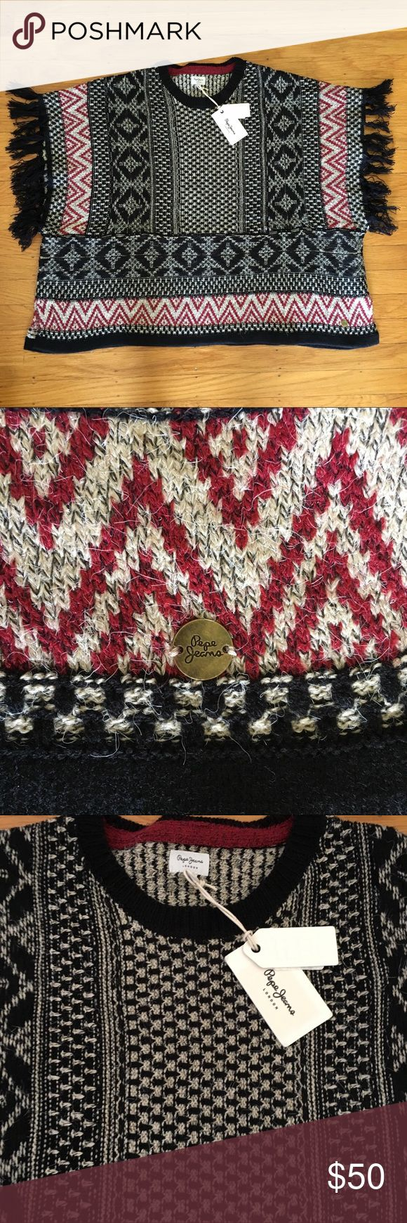 Pepe Jeans poncho sweater cape Black, brick red and cream sweater poncho cape with geometric aztec print and fringe at arms.  Pull over with wide arms hope and slits at each side.  Pepe Jeans from ASOS ASOS Sweaters Shrugs & Ponchos