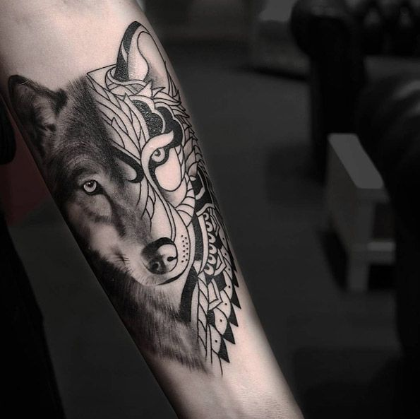 Divided wolf tattoo on forearm by Urban Art