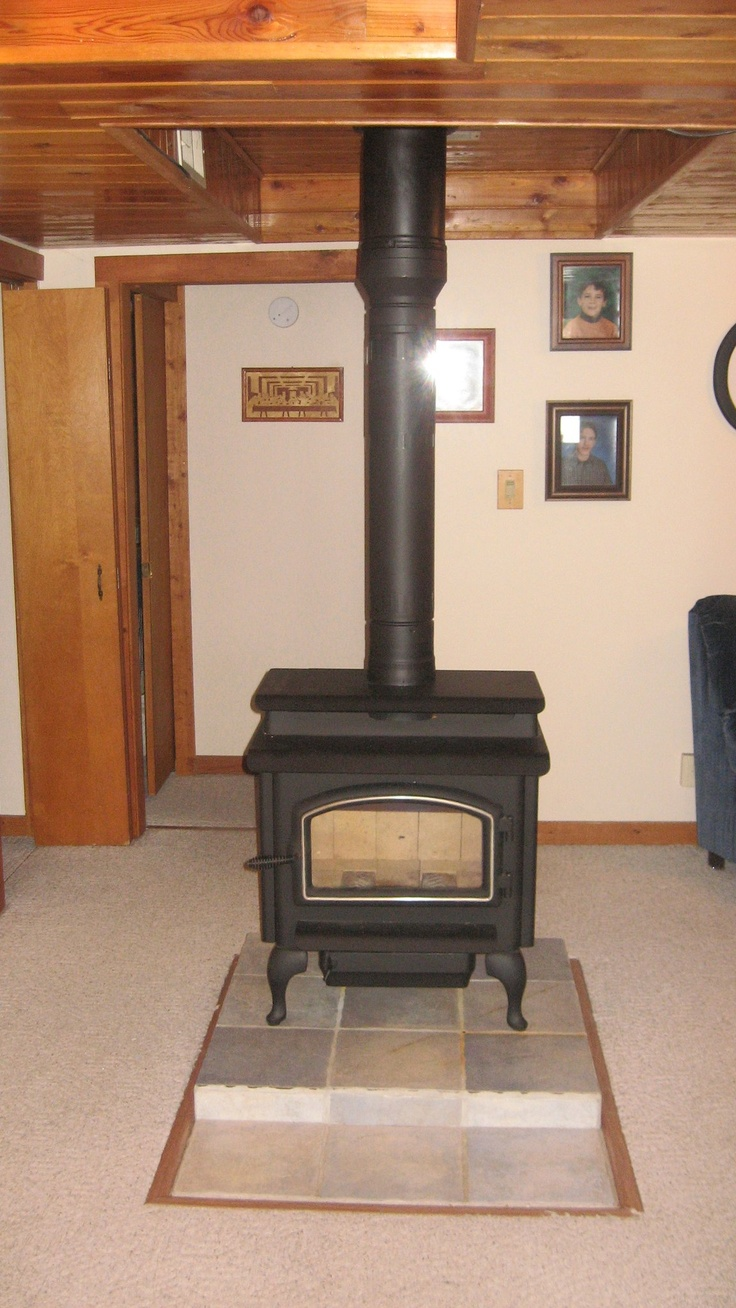 wood burning stove installed in a basement