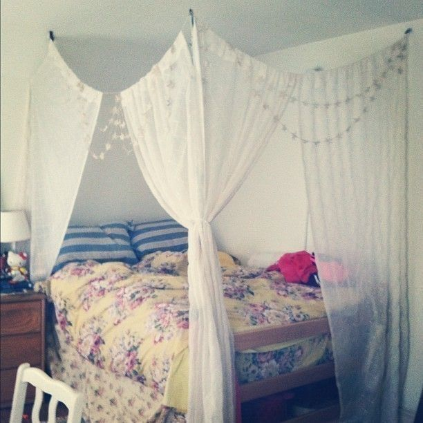 <p>For those struggling with the dorm room regulations colliding with the need to be chic. A college student gets creative and makes a bed canopy from a tree branch, two 3M hooks and some regular white-linin curtains with some string. Best part? It passed regulation inspection!</p>