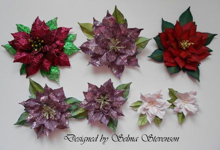 You can create different size poinsettias with the Susan's Garden Poinsettia dies. http://selmasstampingcorner.blogspot.com/2013/10/am-excited-to-show-you-my-new-project.html