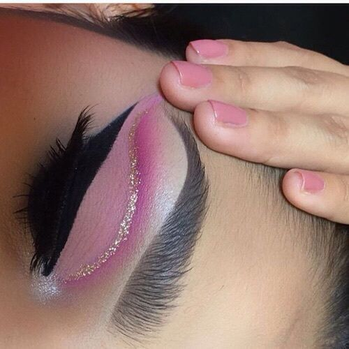 I have included this image because i really like the make up. I was inspired by this eye makeup as i think it is very barbie like and gives a magical feel. I was inspired by the glitter on the eyes also and wanted to add some to my final design to give barbie a magical make up twist.