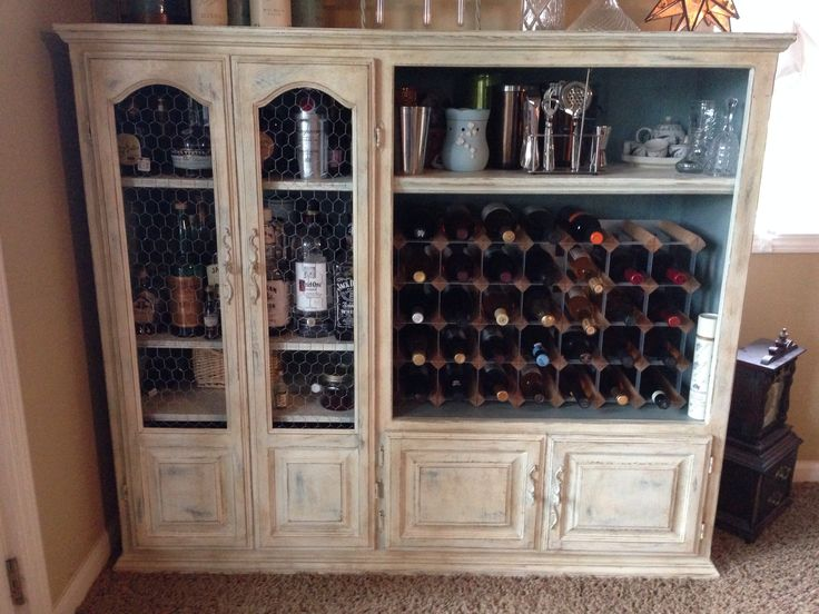 Bar repurposed from $10 craigslist entertainment center. Annie Sloan chalk paint in Duck Egg blue and Old White with dark wax and distressing. I added chicken wire instead of glass doors and built in bead boards for the backing and a wine rack in the 'TV' space. #repurposedfurnitureentertainmentcenter