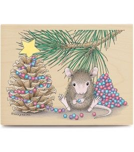 House Mouse decorating his pine cone tree with hanging balls.