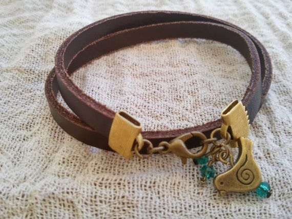 Brown leather bracelet with bronze bird Brown leather by GIASEMAKI