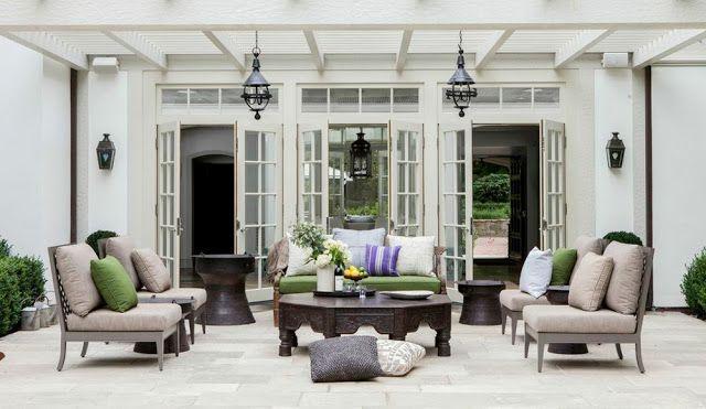 patio living room pergola french doors lanterns sconces french doors stone flooring