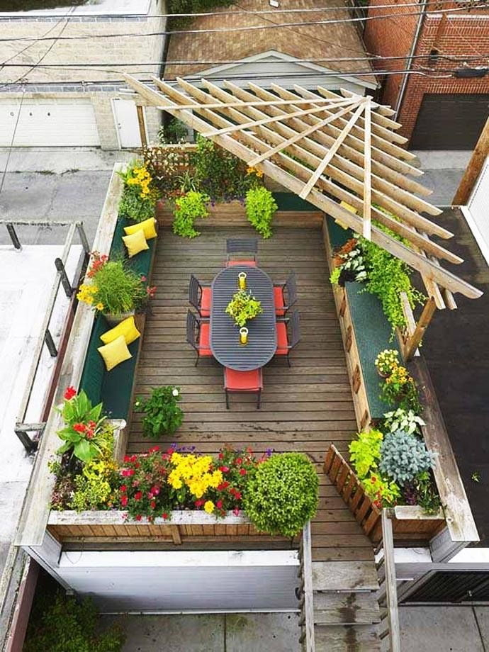 A dash of citrus brights and a corner arbor make this decked Lisbon roof garden a real gem... Compact yet lively, perfect for summer dining. What would you serve on this colourful table?  Picture credit: www.airbnb.com  #Lisbon, #roofterrace, #smallgarden