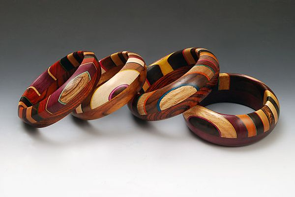 Bangles | Martha Collins. 'Ooom 7'. Each bracelet has fifty pieces of 12 different species of wood and artist-dyed veneer.