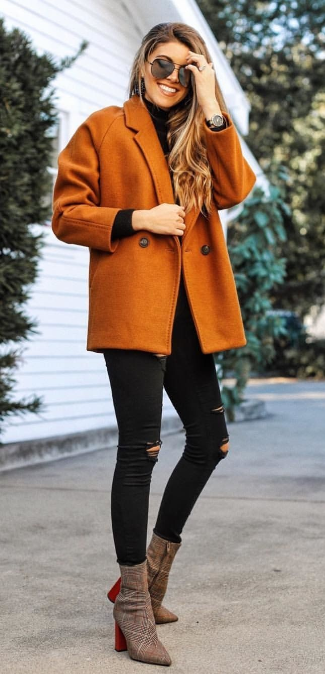 winter  outfits orange notch-lapel double-breasted coat with distressed  black fitted jeans and pair of brown chunky-heeled side-zip mid-calf boots  outfit ca65becc9