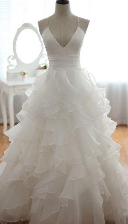 Beautiful white ruffle wedding dress