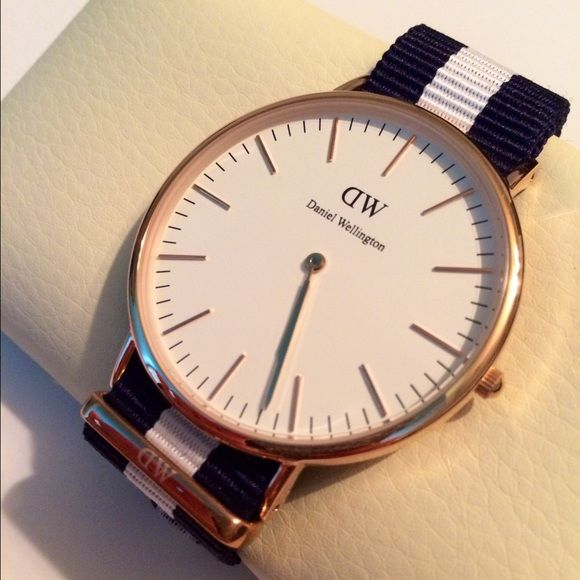 NWOT Daniel Wellington watch this is a men's watch but obviously can be worn on a women. great for a Valentine's Day gift. I got this watch for my boyfriend but we've decided to sell it to help pay for a trip. He's never worn the watch. It's only been taken out of the box once. It's a really beautiful watch! price is negotiable Daniel Wellington Accessories