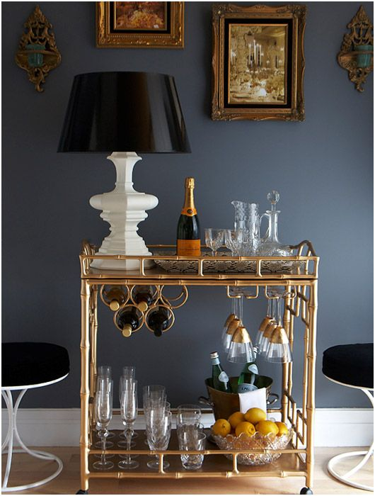 Bamboo bar cart $380   Veuve Clicquot $55   Ombre napkins $50   Hugs & Kisses coasters $48   Mini Jawbone speaker $170   Bubble champagne flutes $38   Gold dipped ice bucket $88   zebra wine stopper $28   red jar candle $24   gold chevron decanter $56