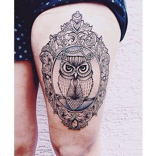 Owl thigh tattoo