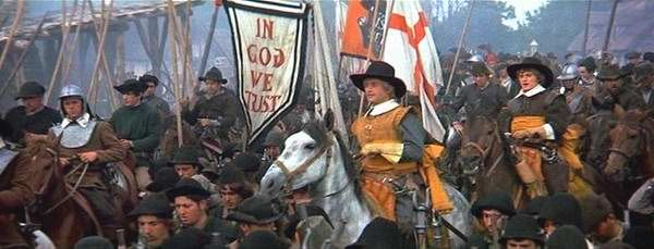 The English Civil War, also called the Puritan Revolution, shows America forming within the womb of England. This was 130 years before the actual birth of the nation in 1776. Here the Puritan Army goes to the Battle of Naseby singing hymns. John Bunyan, writer of Pilgrim's Progress, was with the Puritans in this decisive battle against the king. Note the cavalry officers in the Puritan Army wearing yellow ribbons and yellow sashes and the banner 'In God We Trust'.