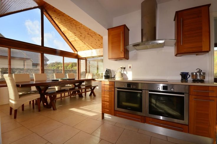 House in Dingle, Ireland. The perfect haven for all who wish to experience the beautiful wild west of Ireland in comfort and style. This contemporary home is spacious with four bedrooms and four bathrooms, ideal for a family or group alike looking for something a bit speci...