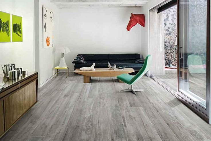 This stunning wood effect porcelain tiled floor looks perfect in this contemporary sitting area.  #porcelain #wood #tiles