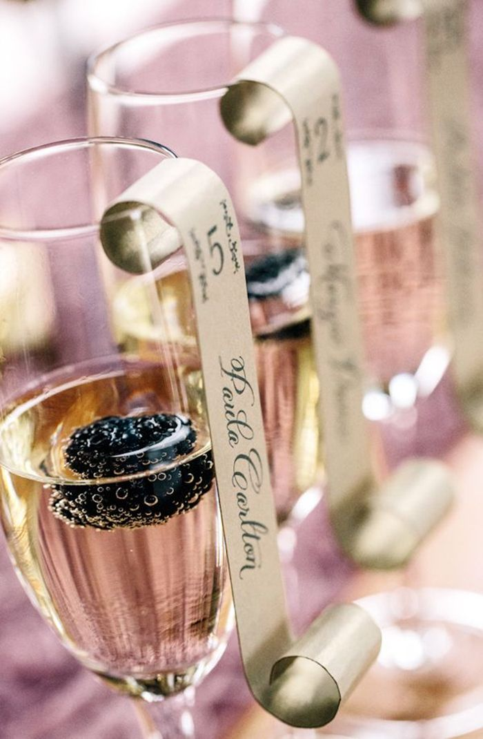 romantic wedding ideas combine champagne toast and escort cards