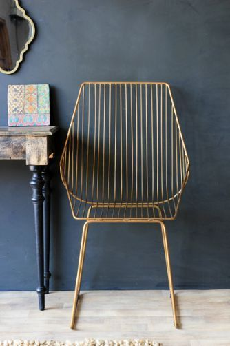 Midas Chair - gold, modern but mixes well with other looks/eras. Works as dining chair, accent chair (just add cushion or slubby/wooly throw) inside or outdoors.