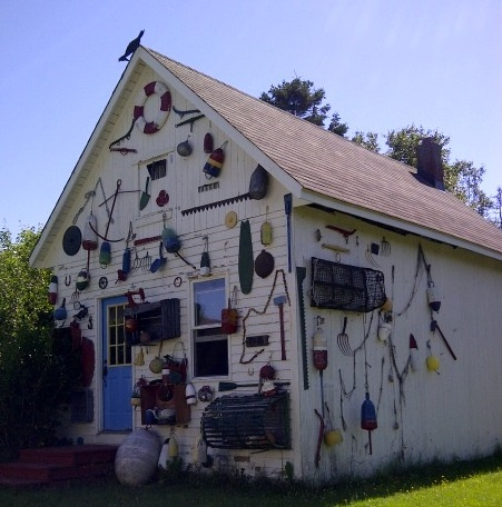 Joy laking is a well known artist who decided to alter the landscape in her front yard by decorating this barn with a collection of garden and Nautical pieces.