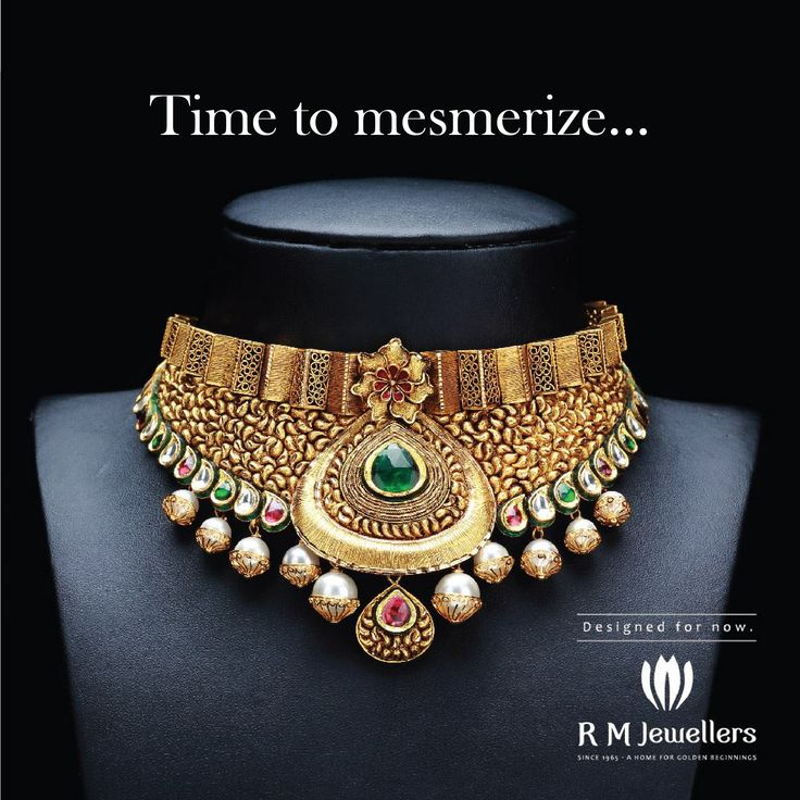 A traditional gold choker adorned with rubies and emeralds...