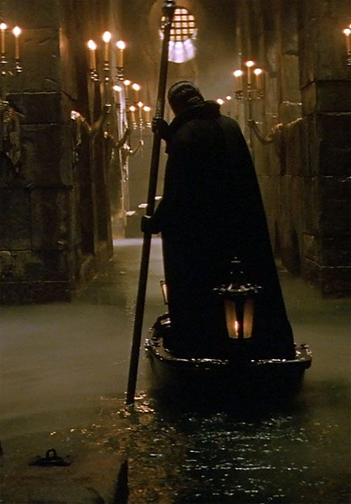 Erik the Phantom of the Opera (Webber version) on a boat in a flooded underground tunnel