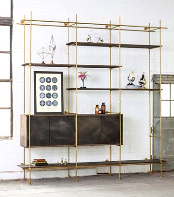 The Collector's Shelving System BY AMUNEALThe Collector's Shelving System is fully adjustable and designed to be configured for any space. Shelves and Credenza in oxidized Oak, Framework in solid brass with a warm finish.