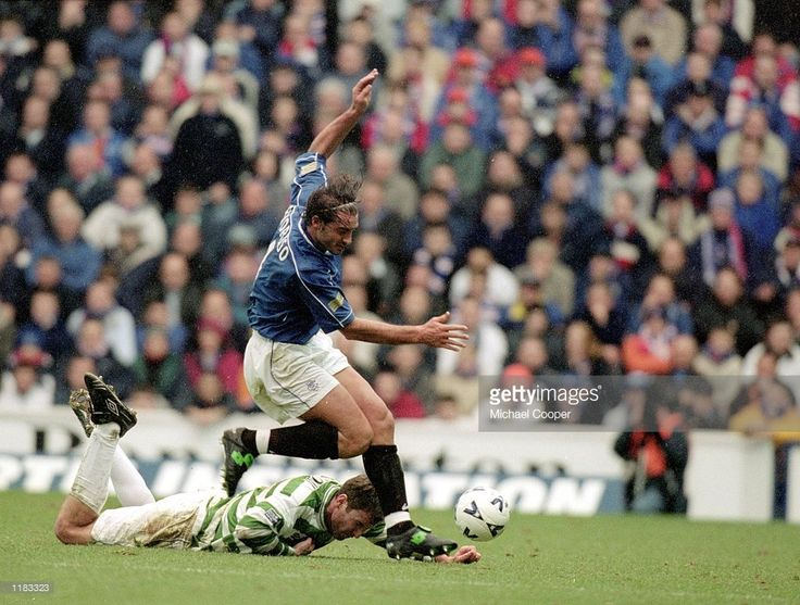 Lorenzo Amoruso of Rangers knocks Chris Sutton of Celtic off the ball during the Scottish Premier League match played at Ibrox, in Glasgow, Scotland. Rangers won the match 5-1. \ Mandatory Credit: Michael Cooper /Allsport