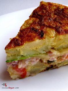 Tortilla española rellena. Receta de cocina casera elaborada paso a paso, con fotografías en cada uno de los pasos. Receta de papas.