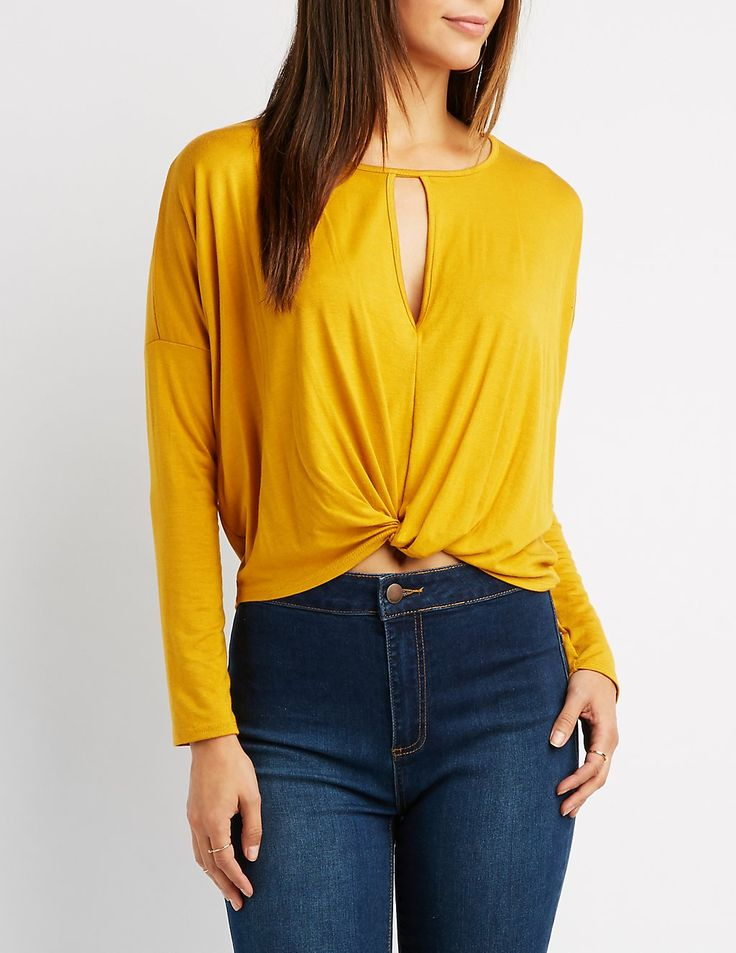 The go-to top for your fall wardrobe! Long dolman sleeves frame a classic boat neckline that tops a keyhole for a flirty peep of skin. A twisted hem gathers in front for a trendy touch of style below!