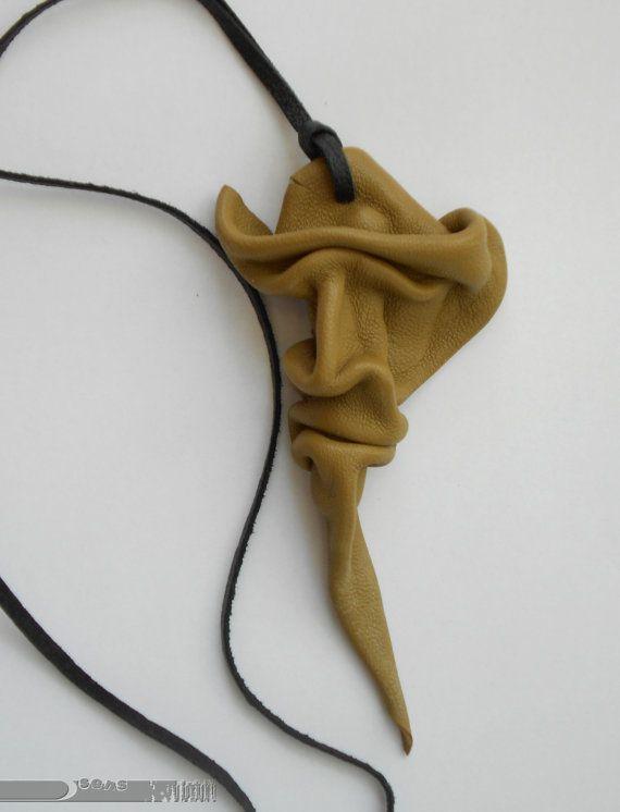 Leather pendant -cowboy face
