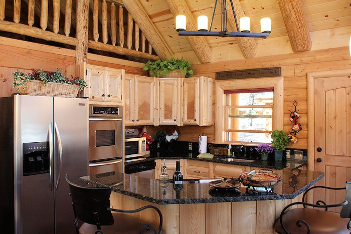 Log Cabin Kitchen With Black Granite Counters Log