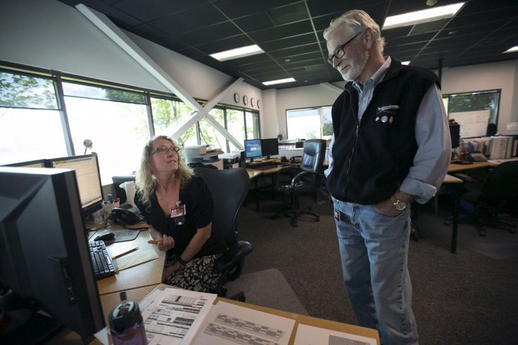 Erin Leacock, manager of customer operations (left) talks with flight control manager Gordy Budden in Horizon Air's operations center in Portland, April 26, 2016. Portland has slowly gained an airline of its own in Horizon Air, Alaska Air's regional affiliate.