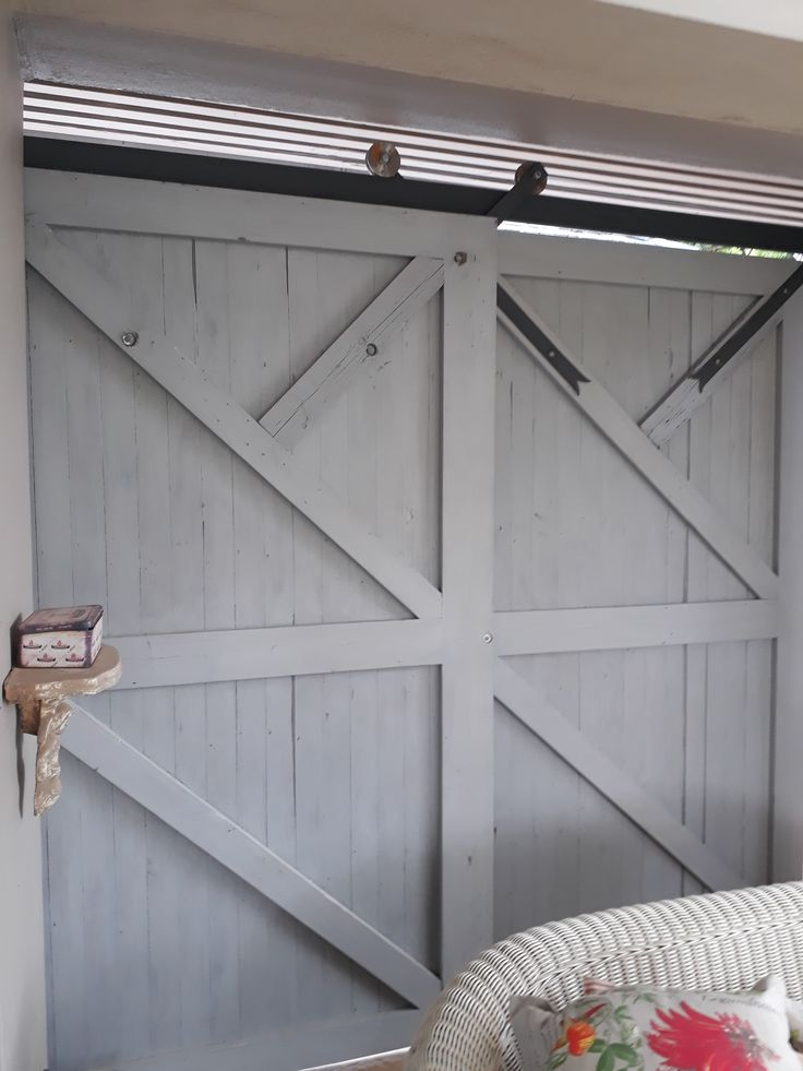 Pair of sliding doors on single top hung track - doors slide to the left to 'stack away' and open fully. Wheel Straps set at 45degrees to allow overlap of only 100mm(wheel size) when 'stacked' away in the open position. When opening the leading door 'pulls' the other door when it reaches half way.