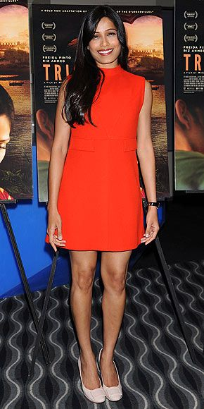 Love Freida Pinto's choice of a watch as her only accessory - they're an often-overlooked (but chic!) addition to a pretty, simple outfit like her red shift and Roger Vivier heels.