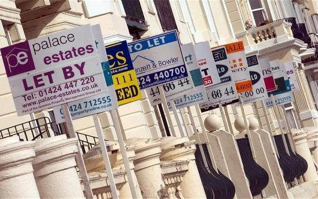 A row of houses with 'to let' signs