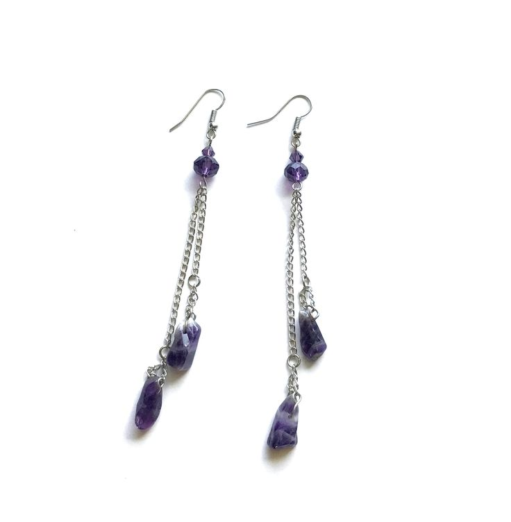 """Natural raw amethyst earrings from the """"Gifts of the Nature"""" Collection.  In creating these awesome earrings we used natural amethyst.  Amethyst calms the emotions, encourages clarity of thought, and assists in attaining wisdom. Amethyst is a stone of the mind which brings calmness and clarity. It is said to attune its wearer with intuition, feelings and values. It is the birthstone for February and is mentioned under the astrological signs Pisces, Aries, Aquarius, and Sagittarius."""