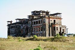 Abandoned Bokor Hill Station- Preah Monivong National Park, southern Cambodia (Construction started in 1921 on Dâmrei Mountains, about 20 km as the crow flies (42 km by the road) West from the town of Kampot. It was used as the location for the final showdown of the movie City of Ghosts (2002) and the 2004 film R-Point. To the northeast is Povokvil Waterfalls)