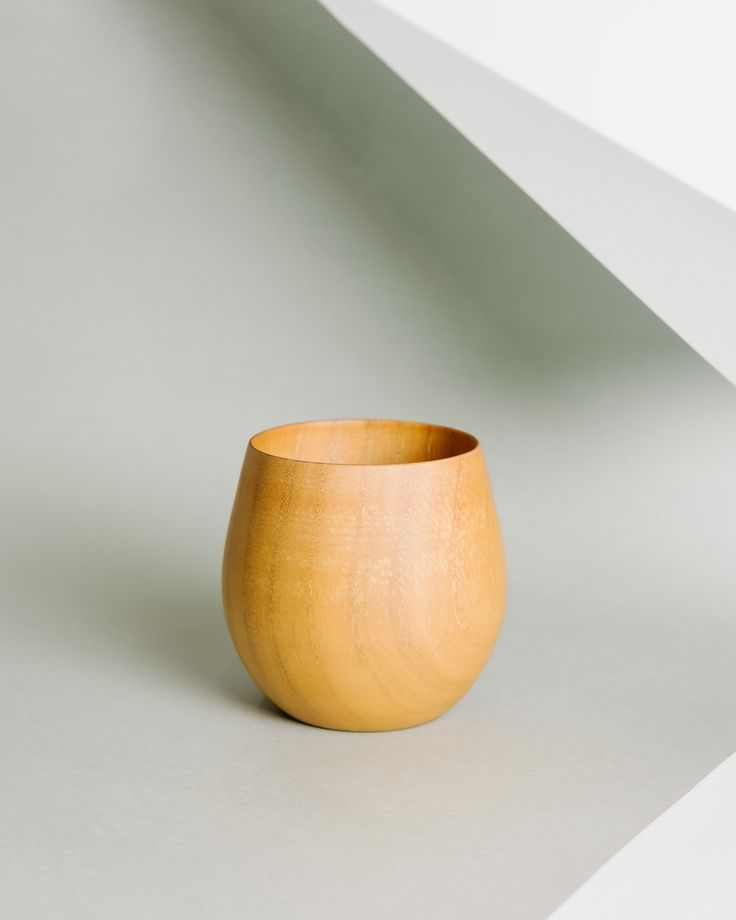A wooden cup will upgrade your kitchen set.