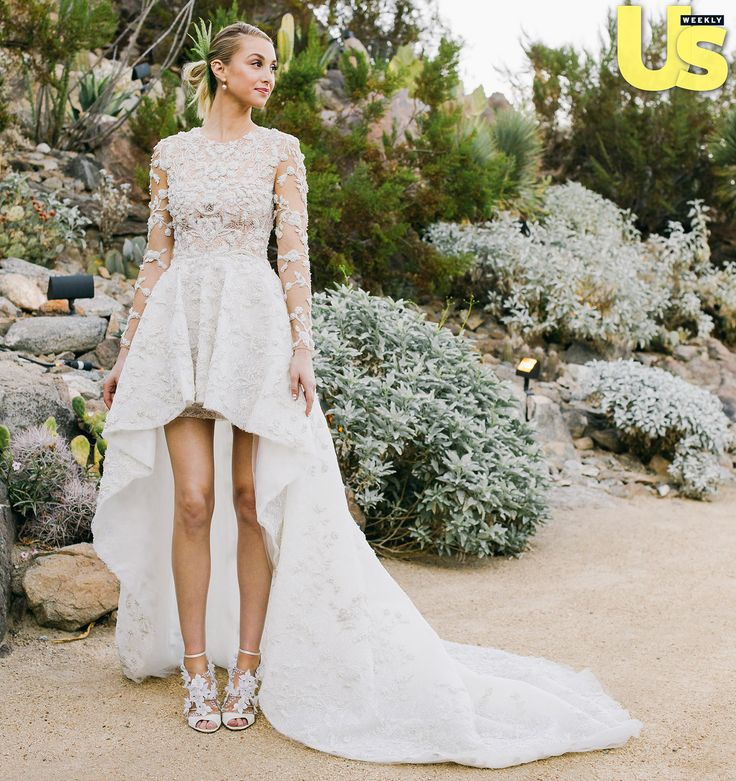 Traditional bride? No way! When Whitney Port tied the knot with Tim Rosenman on Saturday, Nov. 7, the fashion designer and reality TV alum wore a custom-made gown, which featured a waterfall hemline. Get the details at Usmagazine.com!