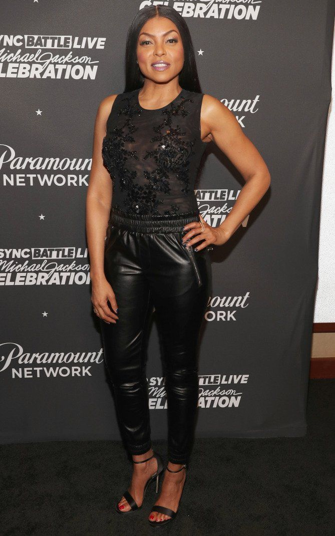 Taraji P Henson in a black sheer top and leather pants